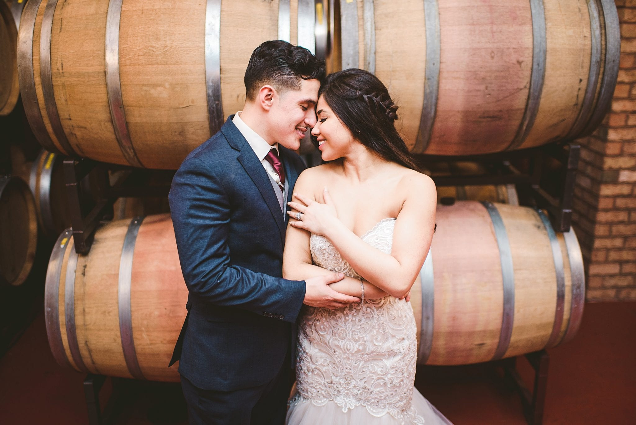 Bride and Groom with wine barrels